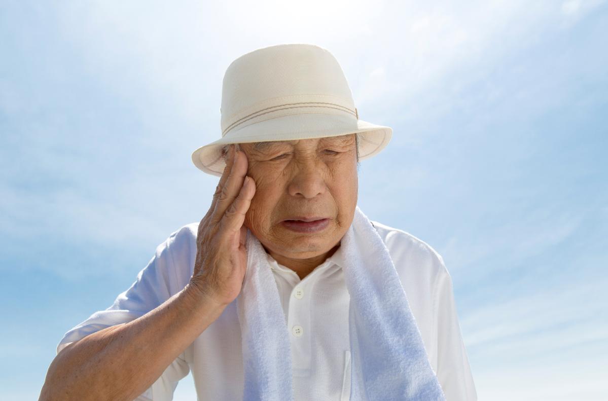 older man in summer heat
